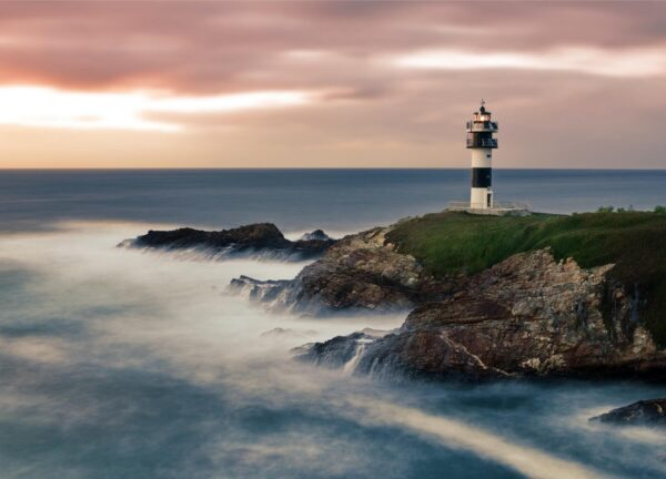"""""""Atlantic Moods #2"""" Artwork is a colour photograph of a lighthouse on the island during the day. The photograph carries pastel light colours. Art print available in different mediums."""