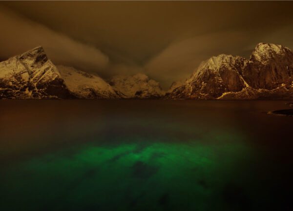 """""""Lofoten Voyage #2"""" Artwork is a colour photograph of Northern light reflection in the water and the snowy mountains on the background. Art print available in different mediums."""