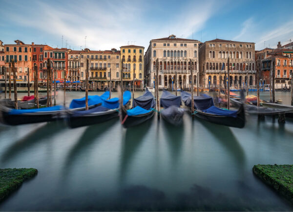 """""""Canal Grande I"""" Artwork is a coloured photograph of canal in Venice with gondolas at the foreground and the houses at the back."""