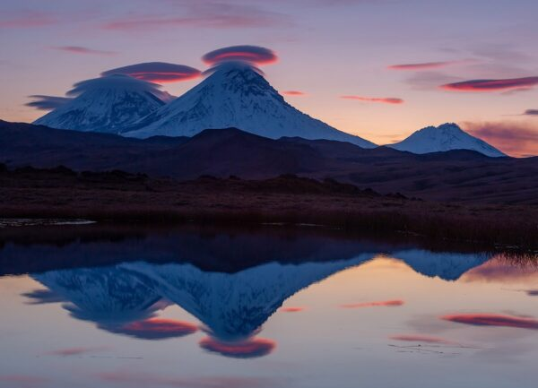"""""""The Sleep of the Clouds"""" Artwork is a wild life photograph of two mountains and the clouds around their tips."""