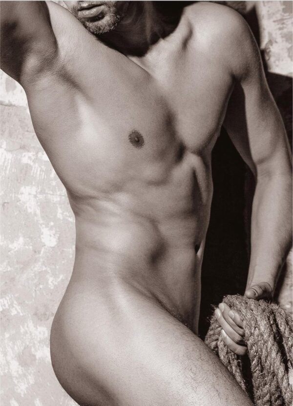 """""""Bodily"""" Artwork is a sepia photograph of a nude man standing and flexing his muscles. The photograph focused on his lips, shin and upper body."""