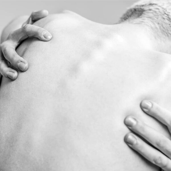 """""""Sensuous #3"""" Artwork is a black and white photograph of a nude man's back. The photograph is taken from behind."""