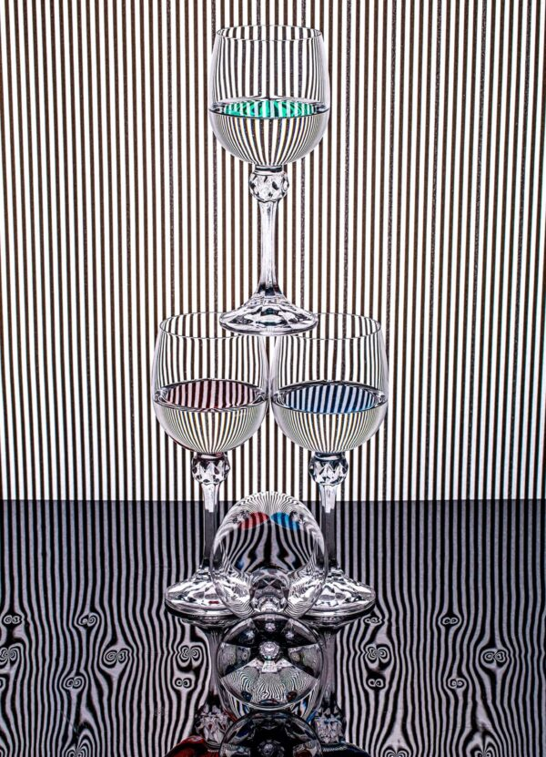 """""""Striped Life #3"""" Artwork is an abstract photograph of three glasses in a form of a pyramid and one glass in front of it. Art print available in different mediums and sizes."""