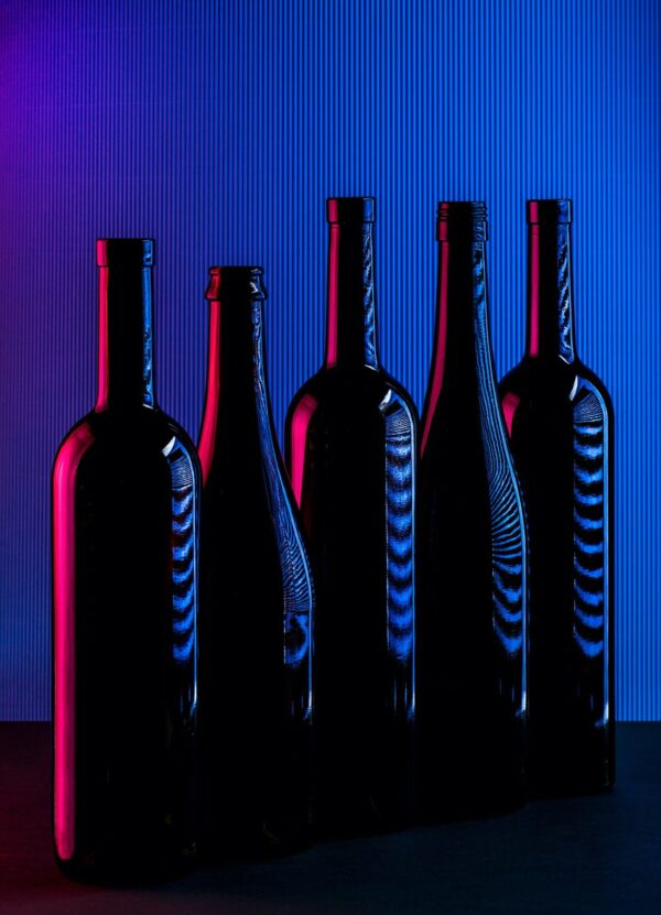 """""""Five"""" Artwork is an abstract photograph of five dark bottles on a glitchy background. Art print available in different mediums and sizes."""