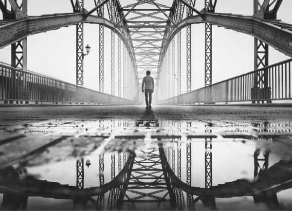 """""""Old Hamburg Bridge I"""" Artwork is a black and white photo of a bridge in Hamburg and the man in the center."""