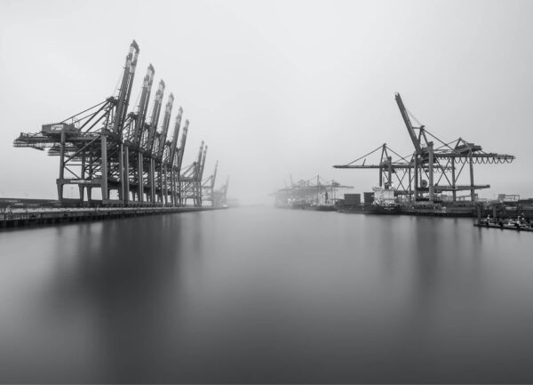 """""""Waltershof bnw I"""" Artwork is a black and white photo taken from the water on unloading point on the Hamburg docks."""