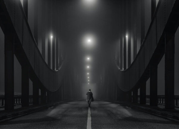 """""""Urban Melancholy"""" Artwork is a black and white photo of a bridge and a man in a coat walking down it."""