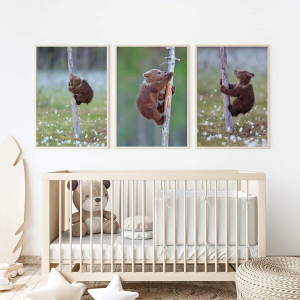 """Paper prints """"Climbing Up"""" by Valtteri Mulkahainen framed into light wood shown in the interior (kid's bedroom)."""