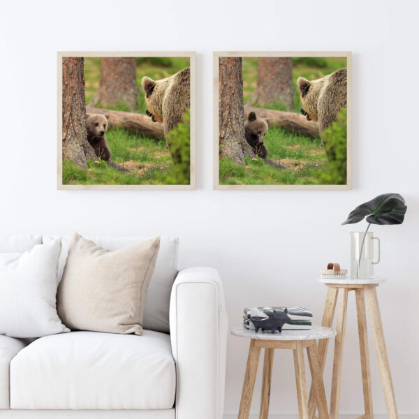 """Paper print """"Mom, it's not my Fault"""" by Valtteri Mulkahainen framed into lights wood shown in the interior (living room)."""