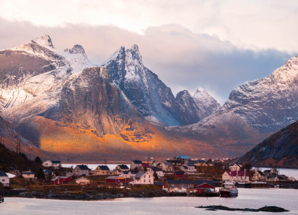 """""""Northern Norway"""" Photograph is a colour artwork capturing the lake in the Northern Fjords, the mountains and the village by it."""