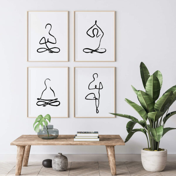 """Paper prints """"Spiritual Meditation"""", """"Spiritual Namaste"""", """"Spiritual Yoga"""" and """"Spiritual Yoga Tree"""". by Miriam Bischoff framed into light wood shown in the interior (living room)."""