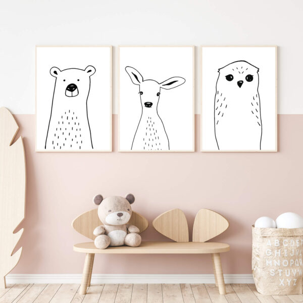 """Paper prints """"Clever Owl"""", """"Tiny Bear"""" and """"Sweet Deer"""" by Miriam Bischoff framed into light wood shown in the interior (kid's bedroom)."""